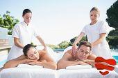 Calm couple enjoying couples massage poolside against heart