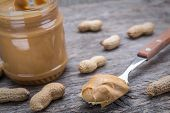 Peanut Cream In Spoon. Dietary Foods For The Heart.