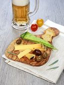 Olives Provencal, Solid Cheeses And A Glass Of Unfiltered Beer