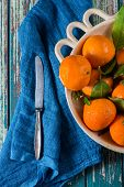 Market Fresh Clementines In Rustic Bowl, On Wooden Table With Cloth