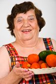 Laughing Grandma Holding Tomatoes