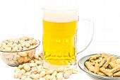 Crisps, Pistachios And Glass Of Beer On White