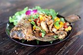 fired fish with vegetable Thailand food yummy