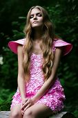 Blond Woman In Pink Dress In Forest