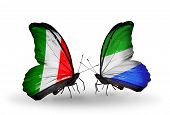 Two Butterflies With Flags On Wings As Symbol Of Relations Italy And Sierra Leone