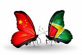 Two Butterflies With Flags On Wings As Symbol Of Relations China And Guyana