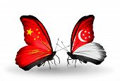 Two Butterflies With Flags On Wings As Symbol Of Relations China And Singapore