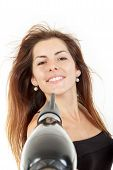 Woman Smiling While Blow Drying Send Air On Her Hair