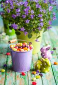 picture of jelly beans  - Easter rabbits and bucket with jelly beans on the vintage wooden table - JPG