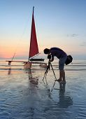 Photographer Is Taking A Photo Of A Sailboat