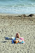 Woman lying on the beach, Marbella.
