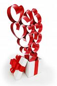 White box with red ribbons and decorative hearts isolated on white background