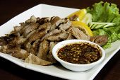 Thai food -  Grilled pork with spicy sauce