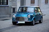 image of cult  - Small classic blue car on the street - JPG