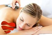 Attractive woman having a massage against heart