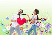 image of girly  - Brunette pulling her boyfriend by the tie against digitally generated girly floral design - JPG
