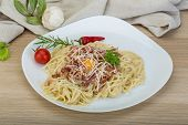 image of carbonara  - Pasta Carbonara with tomato rosemary and basil leaves - JPG