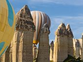 picture of chimney rock  - Balloons flying between fairy chimneys in a valley - JPG