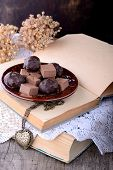 Chocolate truffles on wooden table.