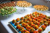 stock photo of buffet catering  - Delicious catering canapes on a buffet table - JPG