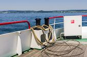 stock photo of bollard  - Boat with mooring rope around a bollard on board and view over the sea - JPG
