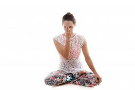 stock photo of pranayama  - Yoga girl on white background practicing nadi shodhana pranayama  - JPG