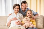 stock photo of expecting baby  - Happy family expecting new baby - JPG
