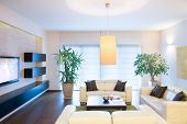 stock photo of comfort  - Stylish modern tv room with comfortable couch - JPG