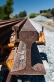 foto of railroad yard  - Multiple rails wait for installation on a train track - JPG