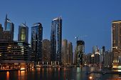 foto of dubai  - A skyline panoramic view of Dubai Marina showing the Marina and Jumeirah Beach Residence - JPG