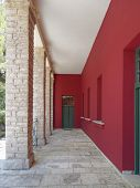 picture of arcade  - red and green building arcade, Kalvryta Greece