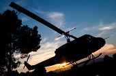 image of helicopter  - silhouette of a helicopter with sunset background - JPG