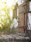stock photo of wooden shack  - Threshold of the house with an old wooden door - JPG