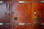 image of woodcarving  - Old cherry wood locker in grungy retro looks - JPG