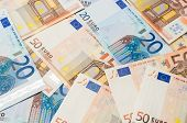 foto of fifties  - The background make from twenty ant fifty euro banknotes - JPG