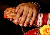 stock photo of indian wedding  - Newly wed Indian couple clasp hands - JPG