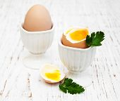 picture of boil  - boiled eggs for breakfast on a old wooden table - JPG
