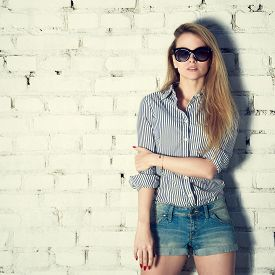 pic of independent woman  - Portrait of Young Hipster Woman on White Brick Wall Background - JPG