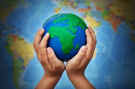 image of ecology  - Ecology concept with earth globe in child hands against blurry world map - JPG