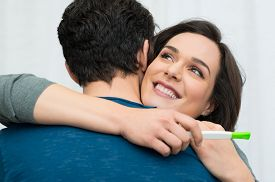 picture of pregnancy test  - Closeup of happy young woman embracing man after positive pregnancy test - JPG