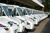 picture of delivery-truck  - some postal delivery trucks in line after work - JPG
