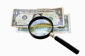 image of two dollar bill  - Two old one dollar bills under a magnifying glass isolated on white - JPG