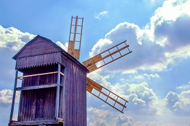 pic of windmills  - a Ukrainian wooden windmill windmill against the sky with clouds - JPG