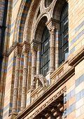 Medieval window with a gargoyle