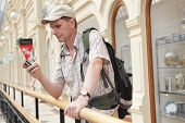 Tourist With Backpack In The Passage poster