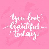 You look beautiful today. Inspirational quote, white brush calligraphy handwritten on pink backgroun poster