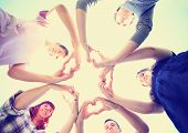 a group of people with their hands in a circle making heart shapes toned with a retro vintage instag poster