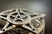 stock photo of wiccan  - pentagram with reflection in the mirror an light - JPG