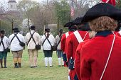 stock photo of revolutionary war  - Musketeers and Drum and Fife Corps at attention during reenactment - JPG