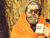Man In Blanket With Cup poster